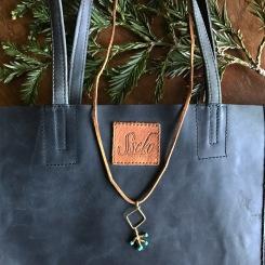 Sseeko Bag & Brave Necklace with Adventure charm | shelbyclarkeblog.com