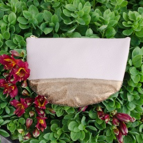 Sseko Designs blush & gold half moon clutch