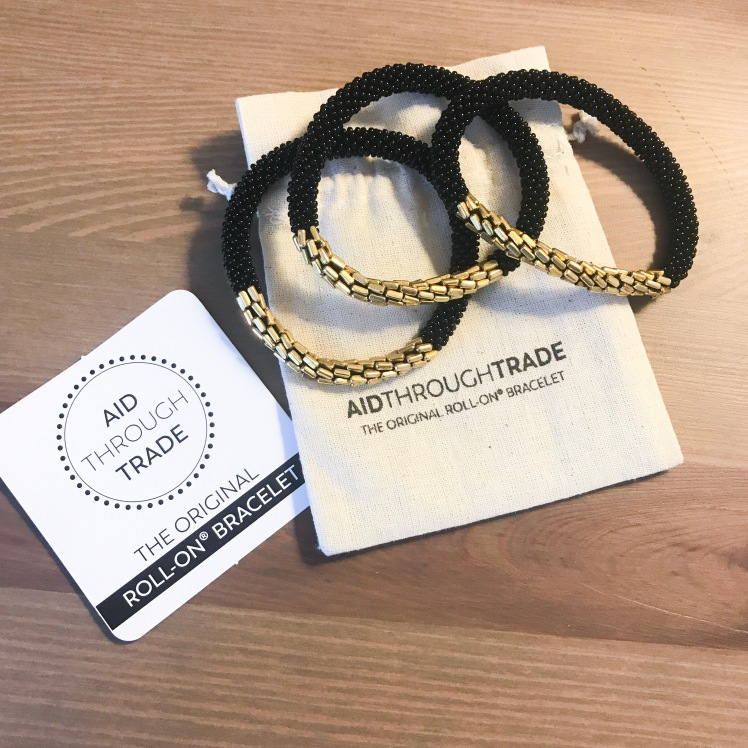 3 black and gold roll on bracelets