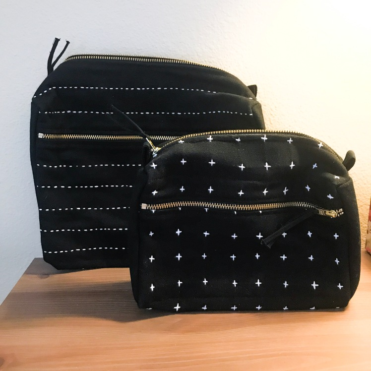2 black bags, one with cross hatches in front and one with stitched lines in the back