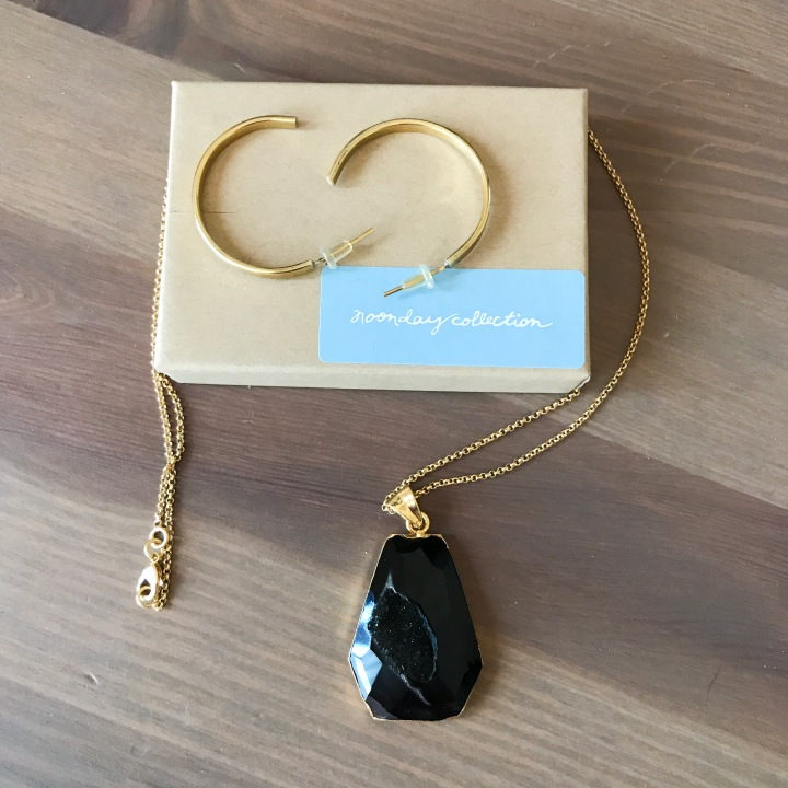 Demi Hoop earrings on a box with black geode stone necklace