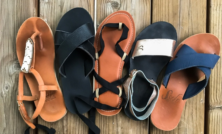 Sandals lined up on the ground